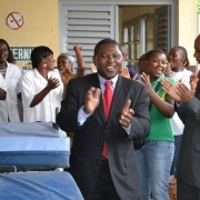 The crowd sings and dances of joy after reciving the donation